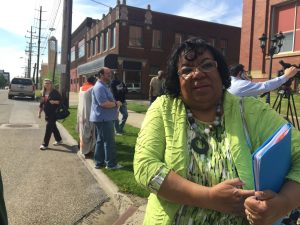 District Rep Kathleen with Youngstown education association President Larry Ellis in the blue shirt behind her attending the May 9th press conference against House Bill 70.